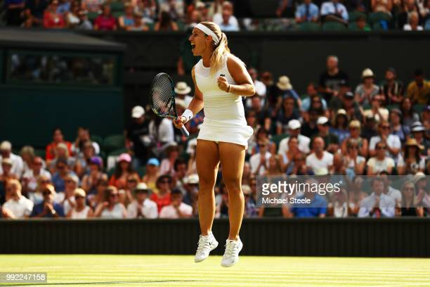 Dominika Cibulkova of Slovakia celebrates after defeating Johanna Konta of Great Britain in their Ladies' Singles second round match on day four of...