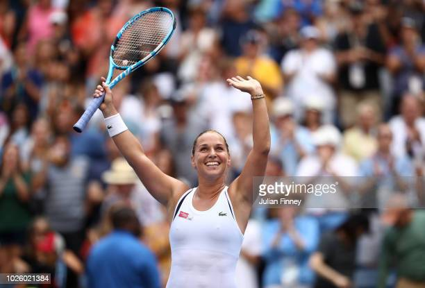 Dominika Cibulkova of Slovakia celebrates after winning her women's singles third round match against Angelique Kerber of Germany on Day Six of the...