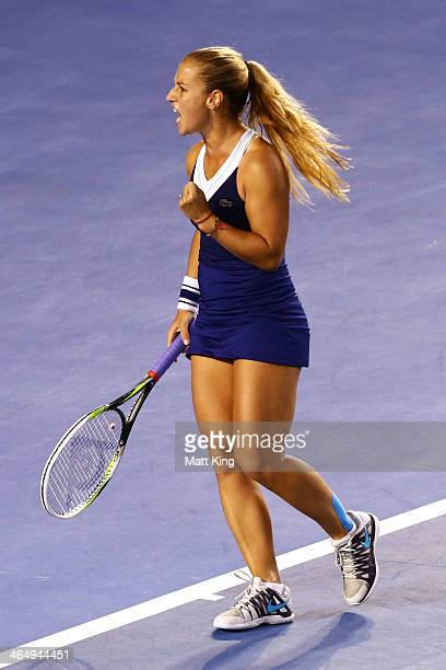 Dominika Cibulkova of Slovakia celebrates breaking serve in her women's final match against Na Li of China during day 13 of the 2014 Australian Open...