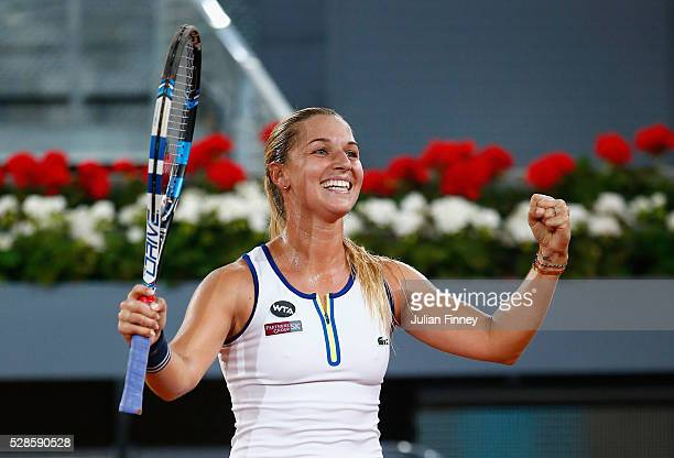Dominika Cibulkova of Slovakia celebrates defeating Louisa Chirico of USA in the semi finals during day seven of the Mutua Madrid Open tennis...