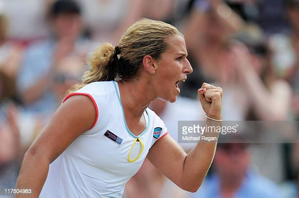 Dominika Cibulkova of Slovakia celebrates match point after winning her fourth round match against Caroline Wozniacki of Denmark on Day Seven of the...