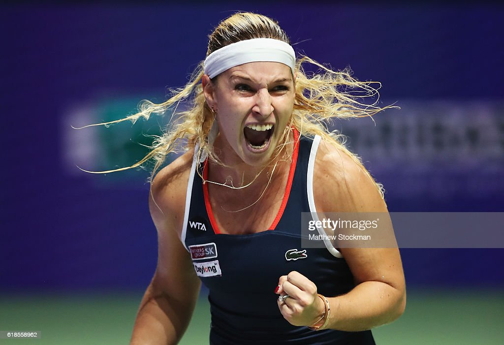 Dominika Cibulkova of Slovakia celebrates victory in her singles match against Simona Halep of Romania during day 5 of the BNP Paribas WTA Finals Singapore at Singapore Sports Hub on October 27, 2016 in Singapore.