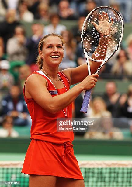 Dominika Cibulkova of Slovakia celebrates victory in her women's singles fourth round match against Victoria Azarenka of Belarus during day 8 of the...