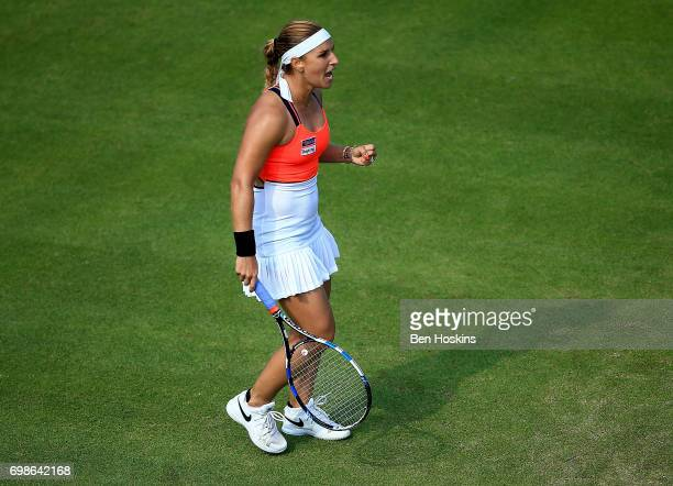 Dominika Cibulkova of Slovakia celebrates winning a point during her first round match against Lucia Safarova of The Czech Republic on day two of The...