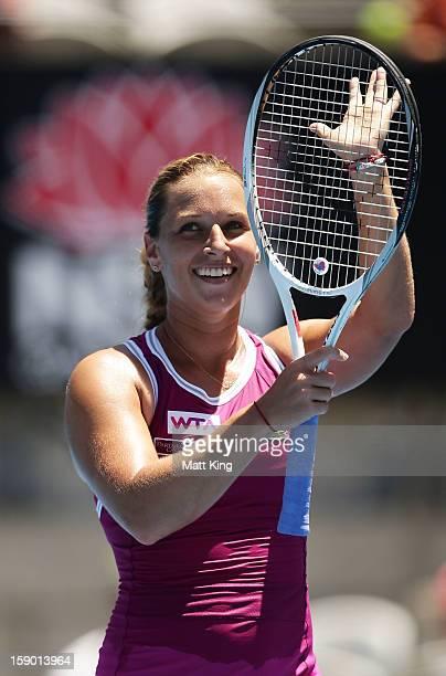 Dominika Cibulkova of Slovakia celebrates winning her first round match against Petra Kvitova of Czech Republic during day one of the Sydney...