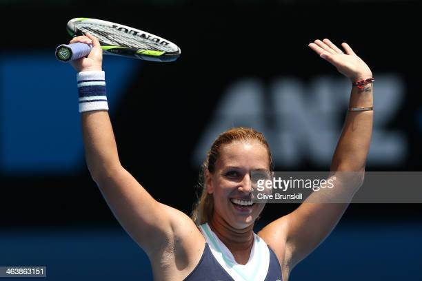 Dominika Cibulkova of Slovakia celebrates winning her fourth round match against Maria Sharapova of Russia during day eight of the 2014 Australian...
