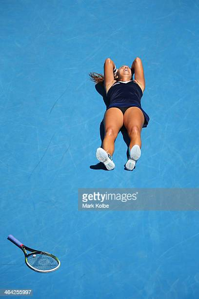 Dominika Cibulkova of Slovakia celebrates winning her quarterfinal match against Simona Halep of Romania during day 10 of the 2014 Australian Open at...