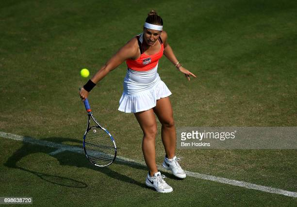 Dominika Cibulkova of Slovakia hits a backhand during her first round match against Lucia Safarova of The Czech Republic on day two of The Aegon...