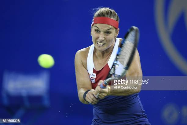 Dominika Cibulkova of Slovakia hits a return against Caroline Garcia of France during their third round women's singles match at the WTA Wuhan Open...