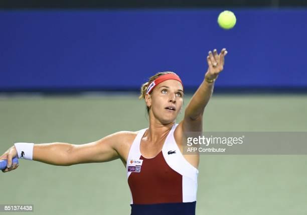 Dominika Cibulkova of Slovakia hits a return against Caroline Wozniacki of Denmark during their women's singles quarterfinal match at the Pan Pacific...