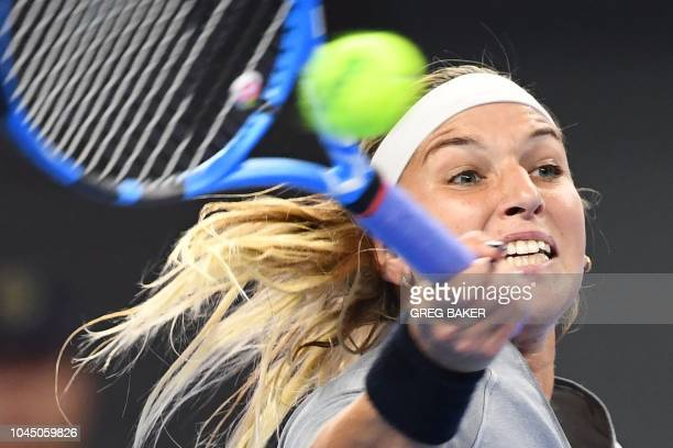 TOPSHOT Dominika Cibulkova of Slovakia hits a return during her women's singles third round match against Sloane Stephens of the US at the China Open...