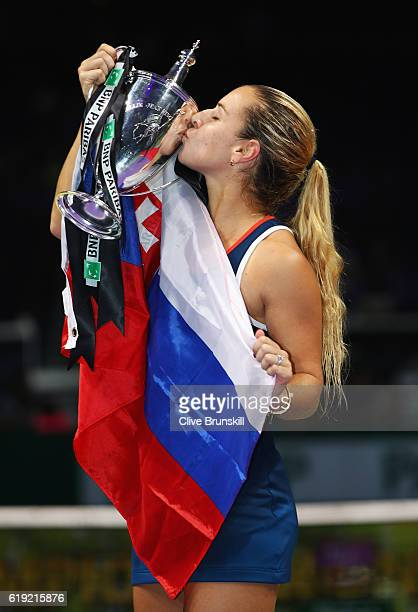 Dominika Cibulkova of Slovakia kisses the trophy after victory in her singles final against Angelique Kerber of Germany during day 8 of the BNP...