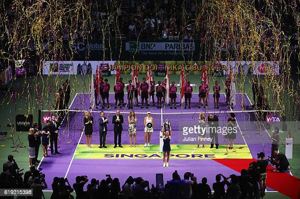 Dominika Cibulkova of Slovakia lifts the trophy after victory in her singles final against Angelique Kerber of Germany during day 8 of the BNP...