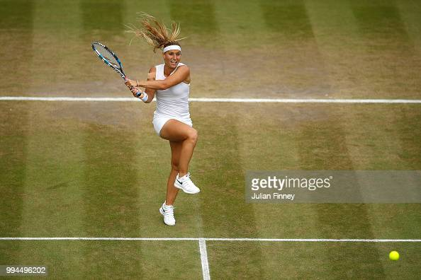 Dominika Cibulkova of Slovakia plays a backhand against SuWei Hsieh of Chinese Taipei during their Ladies' Singles fourth round match on day seven of...