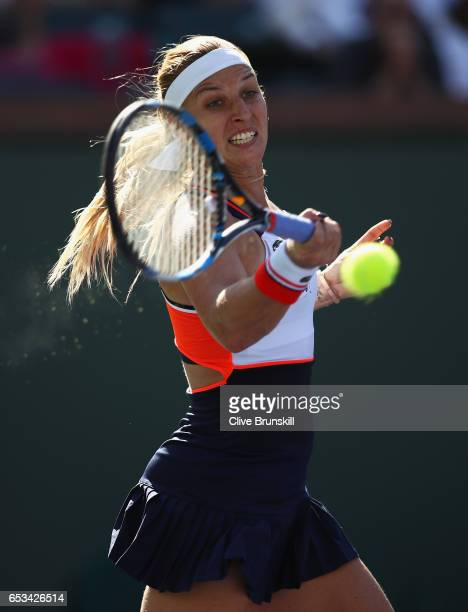 Dominika Cibulkova of Slovakia plays a forehand against Anastasia Pavlyuchenkova of Russia in their fourth round match during day nine of the BNP...