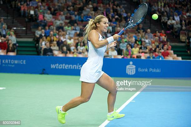Dominika Cibulkova of Slovakia plays a forehand against Pauline Parmentier of France during the WTA Katowice Open second semifinal match on April 9...