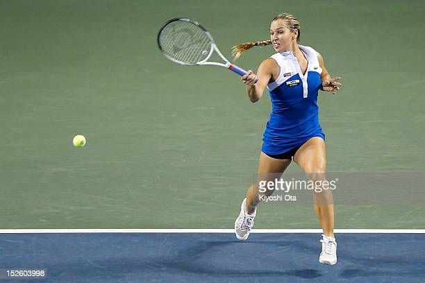 Dominika Cibulkova of Slovakia plays a forehand in her first round match against Anabel Medina Garrigues of Spain during day one of the Toray Pan...