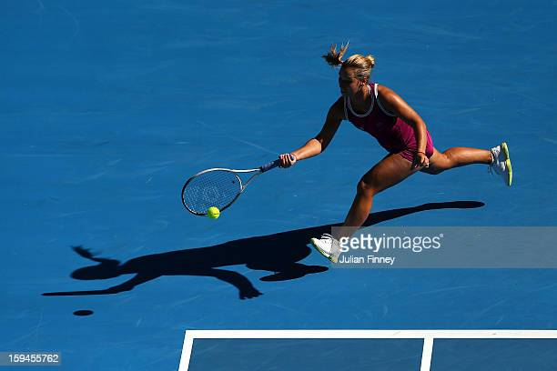 Dominika Cibulkova of Slovakia plays a forehand in her first round match against Ashleigh Barty of Australia during day one of the 2013 Australian...