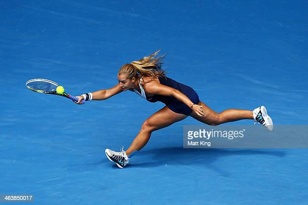 Dominika Cibulkova of Slovakia plays a forehand in her fourth round match against Maria Sharapova of Russia during day eight of the 2014 Australian...