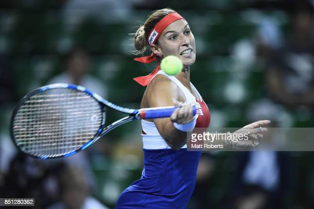 Dominika Cibulkova of Slovakia plays a forehand in her quarter final match against Caroline Wozniacki of Denmark during day five of the Toray Pan...