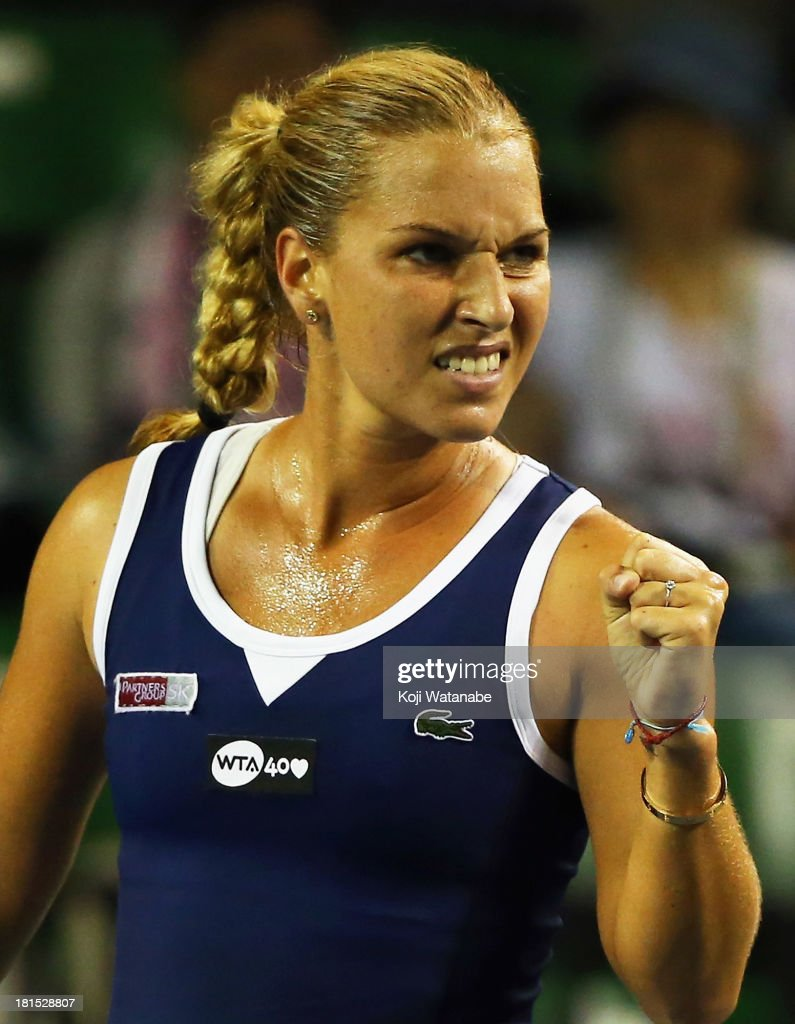 Dominika Cibulkova of Slovakia reacts during her women's singles first round match against Urszula Radwanska of Poloand during day one of the Toray Pan Pacific Open at Ariake Colosseum on September 22, 2013 in Tokyo, Japan.