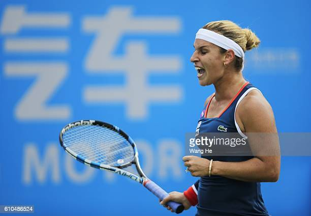 Dominika Cibulkova of Slovakia reacts during the match against Alize Cornet of France on Day 2 of 2016 Dongfeng Motor Wuhan Open at Optics Valley...