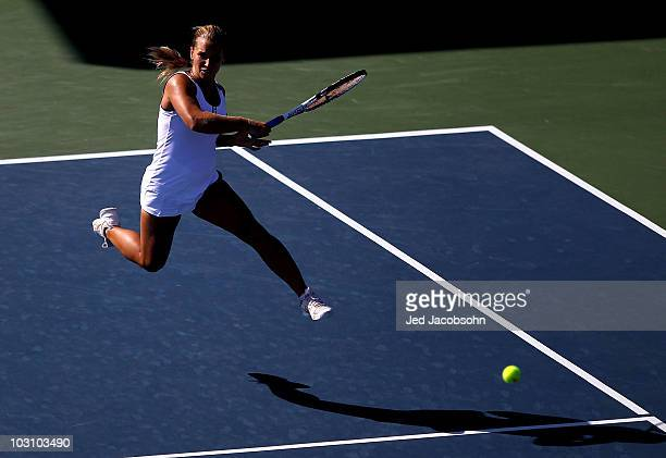 Dominika Cibulkova of Slovakia returns a shot against Hilary Barte during Day 1 of the Bank of the West Classic at Stanford University on July 26,...