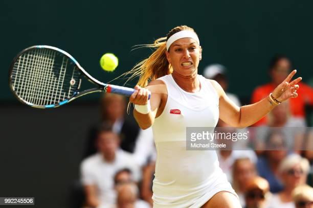 Dominika Cibulkova of Slovakia returns a shot against Johanna Konta of Great Britain during their Ladies' Singles second round match on day four of...