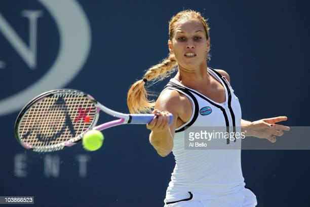 Dominika Cibulkova of Slovakia returns a shot against Svetlana Kuznetsova of Russia during her women's singles match on day eight of the 2010 U.S....