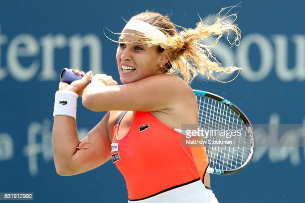Dominika Cibulkova of Slovakia returns a shot to Ana Konjuh of Croatia during day 4 of the Western Southern Open at the Lindner Family Tennis Center...