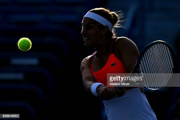 Dominika Cibulkova of Slovakia returns a shot to Anastasia Pavlyuchenkova of Russia during their match on Day 7 of the Connecticut Open at...