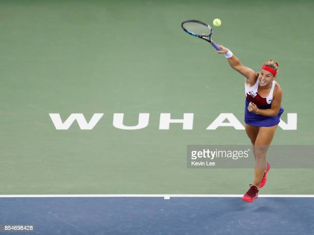 Dominika Cibulkova of Slovakia returns a shot to Caroline Garcia of France at round 3 of Women's Single of 2017 Wuhan Open during Day 4 on September...