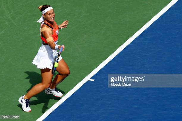 Dominika Cibulkova of Slovakia returns a shot to Elise Mertens of Belgium during Day 7 of the Connecticut Open at Connecticut Tennis Center at Yale...