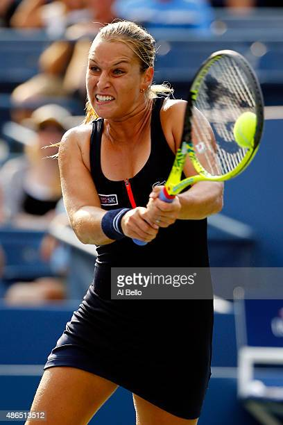 Dominika Cibulkova of Slovakia returns a shot to Eugenie Bouchard of Canada during their Women's Singles Third Round match on Day Five of the 2015 US...