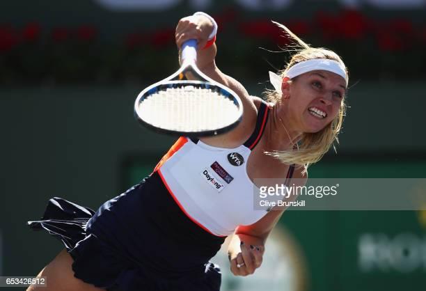 Dominika Cibulkova of Slovakia serves against Anastasia Pavlyuchenkova of Russia in their fourth round match during day nine of the BNP Paribas Open...