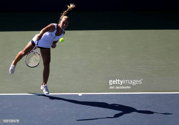 Dominika Cibulkova of Slovakia serves against Hilary Barte during Day 1 of the Bank of the West Classic at Stanford University on July 26, 2010 in...