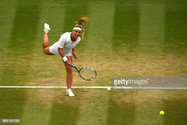 Dominika Cibulkova of Slovakia serves against Jelena Ostapenko of Latvia during their Ladies' Singles Quarter-Finals match on day eight of the...