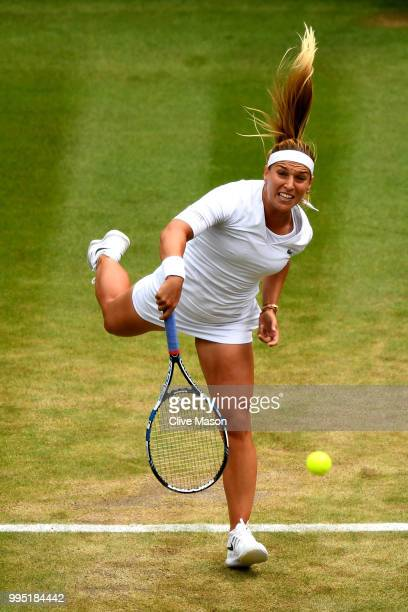 Dominika Cibulkova of Slovakia serves against Jelena Ostapenko of Latvia during their Ladies' Singles QuarterFinals match on day eight of the...