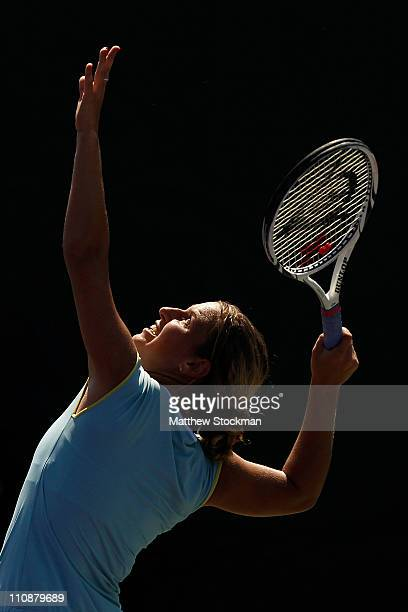 Dominika Cibulkova of Slovakia serves against Timea Bacsinszky of Switzerland during the Sony Ericsson Open at Crandon Park Tennis Center on March...