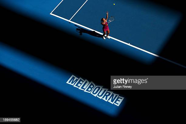 Dominika Cibulkova of Slovakia serves in her first round match against Ashleigh Barty of Australia during day one of the 2013 Australian Open at...