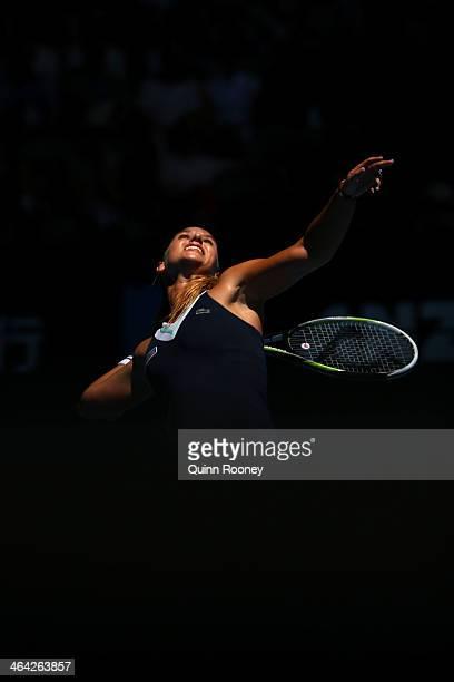 Dominika Cibulkova of Slovakia serves in her quarterfinal match against Simona Halep of Romania during day 10 of the 2014 Australian Open at...