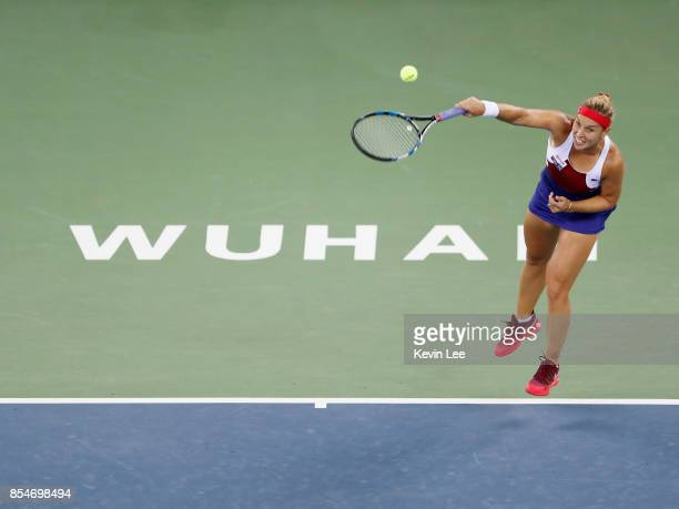 Dominika Cibulkova of Slovakia serves to Caroline Garcia of France at round 3 of Women's Single of 2017 Wuhan Open during Day 4 on September 27 2017...