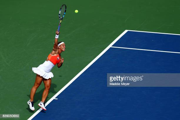 Dominika Cibulkova of Slovakia serves to Elise Mertens of Belgium during Day 7 of the Connecticut Open at Connecticut Tennis Center at Yale on August...