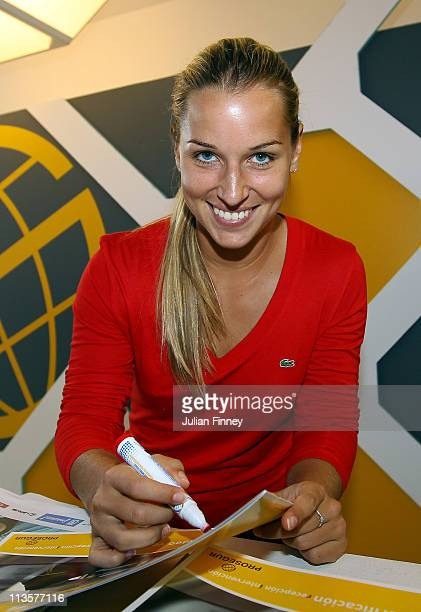 Dominika Cibulkova of Slovakia signs autographs at the Prosegur spanish security booth during day four of the Mutua Madrilena Madrid Open Tennis on...