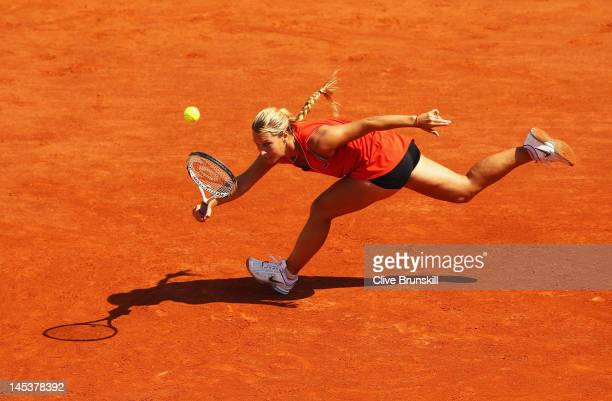 Dominika Cibulkova of Slovakia stretches to hit a forehand in the women's singles first round match between Kristina Mladenovic of France and...