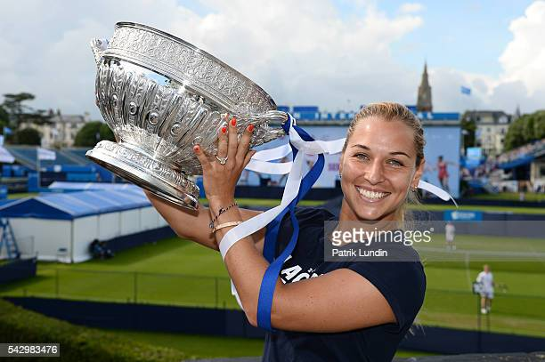 Dominika Cibulkova of Slovakia with trophy after victory in the final match against Karolina Pliskova of the Czech Republic on day 7 at Devonshire...