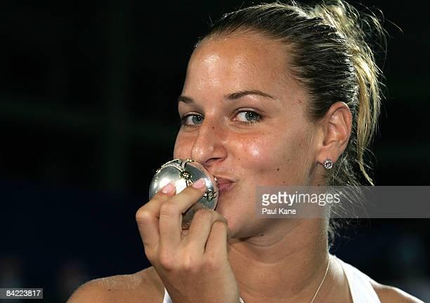 Dominika Cibulkova of the Slovak Republic kisses a diamond encrusted silver ball after defeating Marat Safin and Dinara Safina of Russia during the...