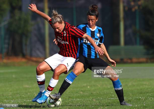 Dominika Conc of AC Milan competes for the ball with Martina Brustia of FC Internazionale during the Women Serie A match between FC Internazionale v...