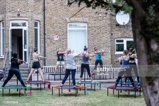 Dominika Lapinska and Agnieszka Kromka run an outdoor jumping fitness training amid Coronavirus pandemic in London, England on August 13, 2020....