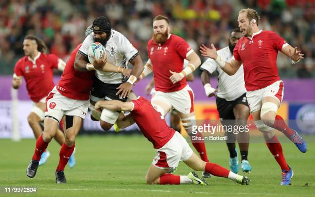 Dominiko Waqaniburotu of Fiji is tackled by Gareth Davies and Jonathan Davies of Wales during the Rugby World Cup 2019 Group D game between Wales and...